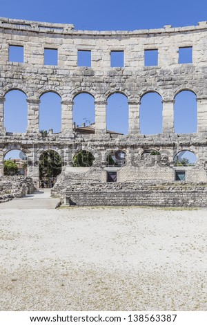 Ruins of Roman amphitheater in Pula. It was constructed in 27 BC - 68 AD and is among the six largest surviving Roman arenas in the World. Pula Arena is best preserved ancient monument in Croatia. - stock photo