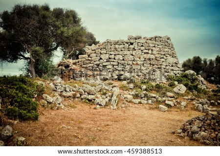 Ruins of talayot - prehistoric construction of the mysterious tribe lived on Balearic islands in Bronze Age. - stock photo