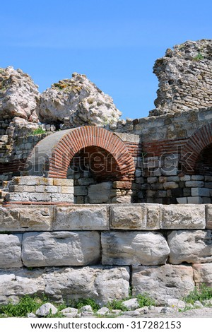 Ruins of the ancient fortress wall around the town of Nesebar in Bulgaria - stock photo