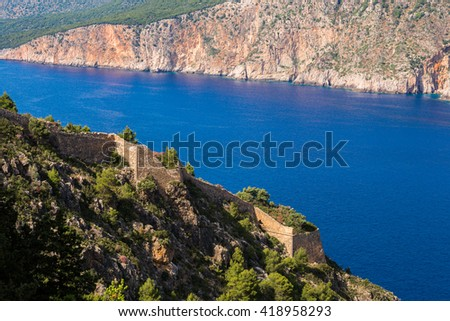 Ruins of the Assos castle (Greece) - stock photo