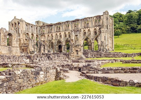 Ruins of the Cistercian Rievaulx Abbey near the market town of Helmsley in North Yorkshire, England - stock photo
