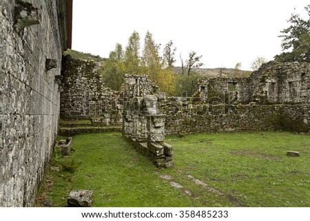 Ruins of the cloister arcade and convent cells at Monastery of Pitoes, Portugal - stock photo