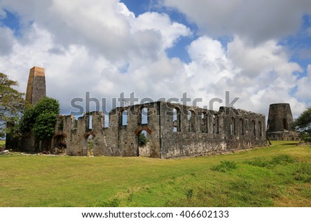 Ruins of the old factory and windmills in Marie-Galante, Guadeloupe (France), Caribbean Islands - stock photo