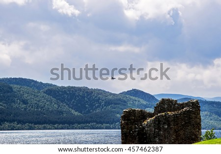 Ruins of the Urquhart Castle in Loch Ness of Scotland. Loch Ness is a city in the Highlands in Scotland in the United Kingdom. - stock photo