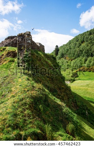 Ruins of Urquhart Castle at Loch Ness in Scotland. Loch Ness is a city in the Highlands in Scotland in the United Kingdom. - stock photo