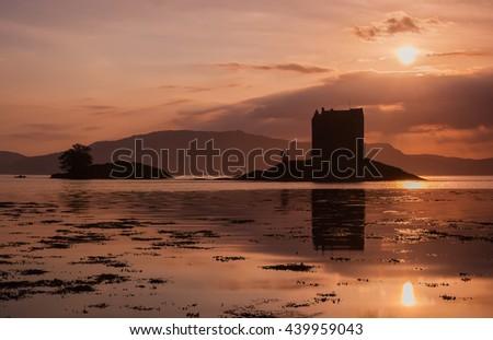 Ruins Scottish Castle Stalker at sunset - stock photo