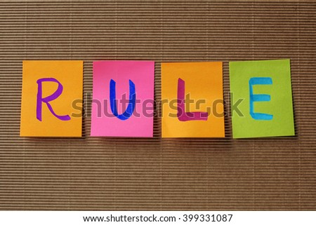 rule text on colorful sticky notes - stock photo