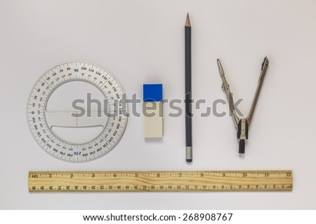 Ruler, compasses, eraser, protractor, pencil - stock photo