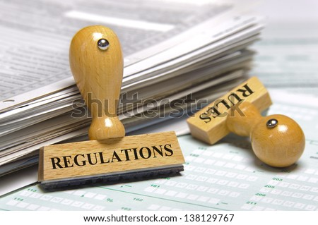 rules and regulations marked on rubber stamp - stock photo