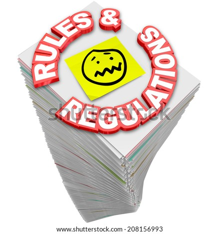Rules and Regulations words in red 3d letters on a stack of paperwork, guidelines, codes, laws and standards you must follow in your business or finances - stock photo