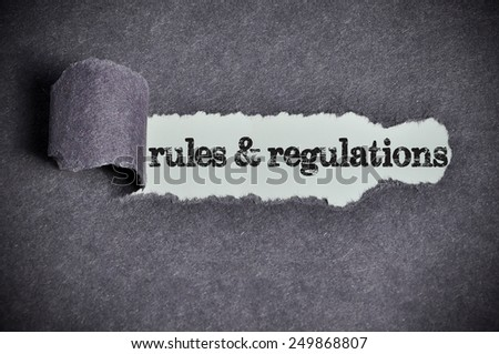 rules & regulations word under torn black sugar paper  - stock photo