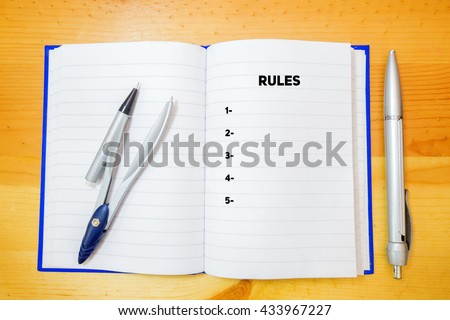 Rules word on a notebook with a pen - stock photo