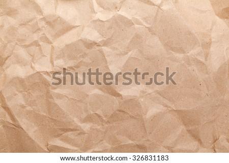 Rumpled brown cardboard paper texture - stock photo