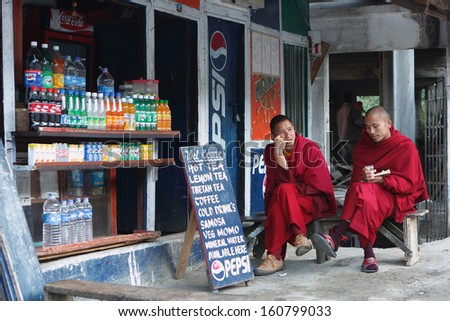 RUMTEK, INDIA - DEC 5: Monks in the Rumtek Monastery on Dec 5, 2008 in Rumtek, India. also called the Dharmachakra Centre, is a Tibetan Buddhist monastery located in the Indian state of Sikkim. - stock photo