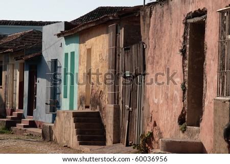 run down multi colored buildings in Trinidad - stock photo