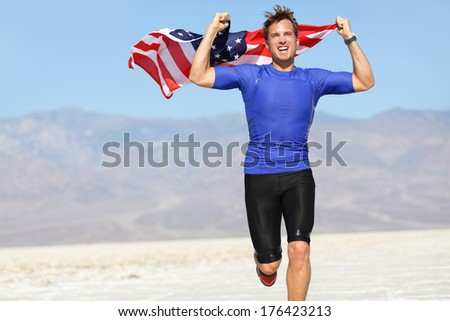 Runner athlete man with the American flag - USA. Running sport fitness man holding US flag. Athletic young man cheering and running with the American flag raised in the air. - stock photo