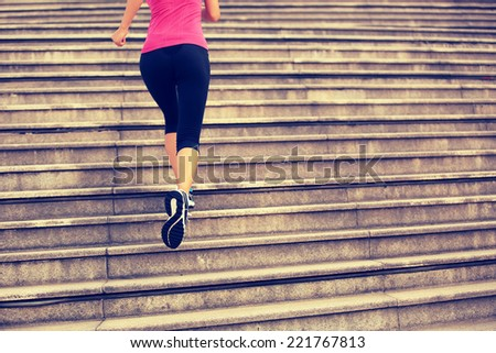 Runner athlete running on city stairs. woman fitness jogging workout wellness concept.  - stock photo