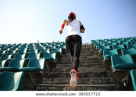 Runner athlete running on stairs. woman fitness jogging workout wellness concept. - stock photo