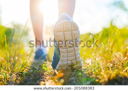 Runner feet running  closeup on shoe - stock photo