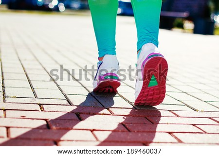Runner Feet Running on road Closeup in shoe. woman fitness workout  concept - stock photo
