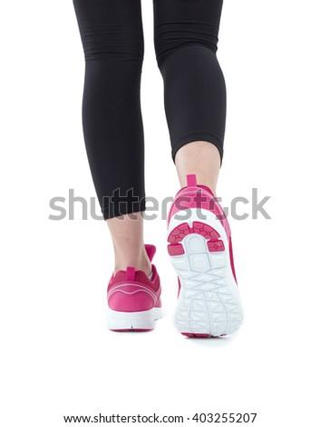 Runner feet running on road closeup on shoe. woman fitness sunrise jog workout welness concept. - stock photo