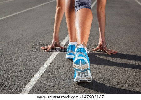 Runner Feet Running on Stadium Closeup - outdoor shot - stock photo