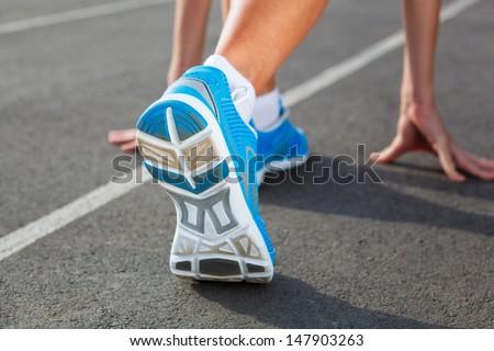 Runner Feet Running on Stadium Closeup - outdoor shot - stock photo