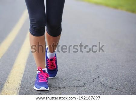 Runner Female Feet Running on Road. Jog - stock photo