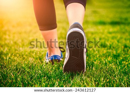 Runner girl - athlete running at seaside, woman fitness, healthy lifestyle - stock photo