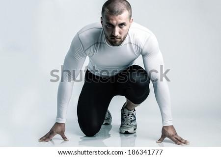 Runner in starting position - stock photo