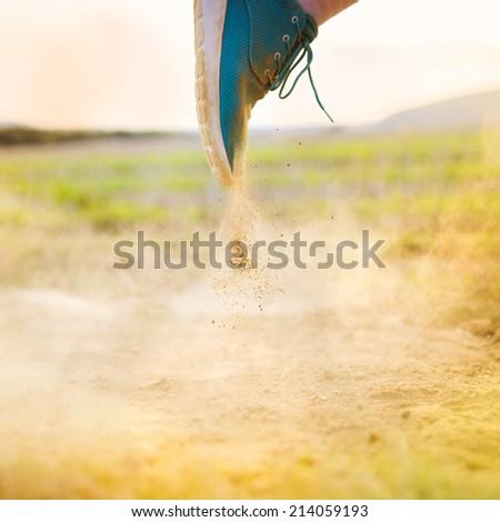 Runner man feet running on countryside road, closeup on shoe - stock photo