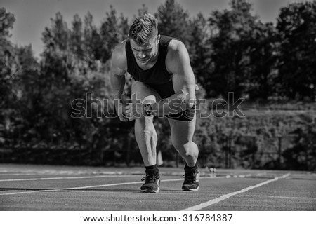 Runner on the track at a sport stadium - stock photo