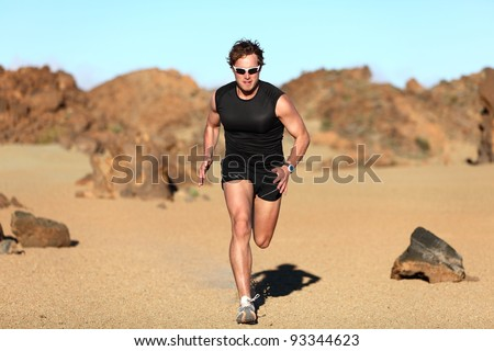 Runner running. Man sprinting in desert training for marathon. Young fit male fitness sport model working out outdoors in amazing desert landscape - stock photo