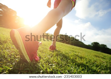 Runner - running shoes closeup of woman barefoot running shoes. Female jogging in Park - stock photo
