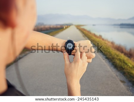 Runner start his watch before jogging - stock photo