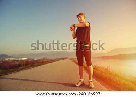 Runner start his watch before training - stock photo