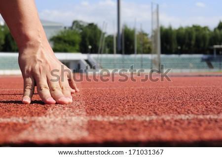 Runner starting action on racecourse. - stock photo