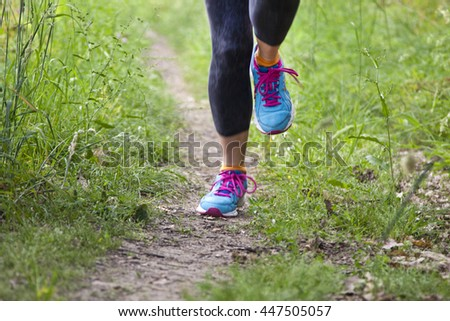 runner training outdoors - stock photo