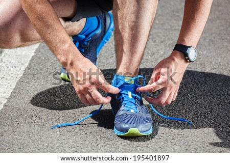Runner trying running shoes getting ready for run. - stock photo