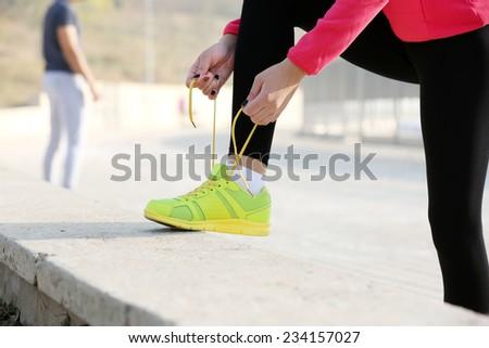 Runner tying shoelaces - stock photo