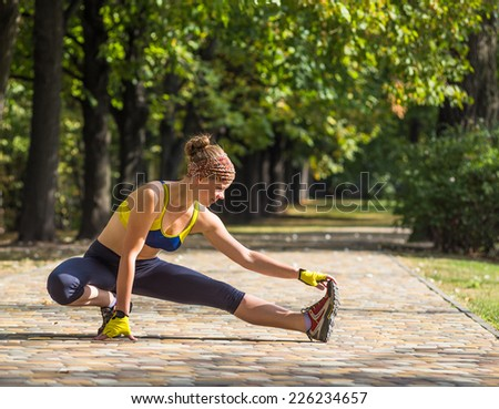Runner woman training in city park outdoor. Caucasian female sport fitness model jogging training for marathon during outdoor workout.  - stock photo