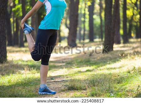 Runner woman training on forest road in beautiful nature. Caucasian female sport fitness model jogging training for marathon during outdoor workout.  - stock photo