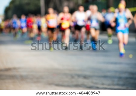 runners in marathon, abstract blurry - stock photo