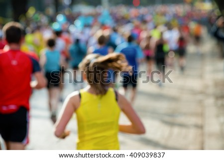 runners in marathon woman abstract, blurry - stock photo