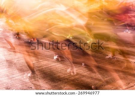 Runners running in city marathon, motion blur on sporty legs - stock photo