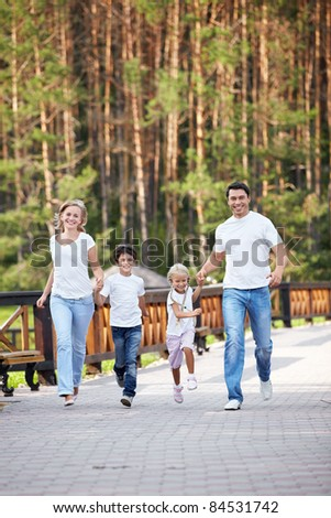 Running a family with children - stock photo