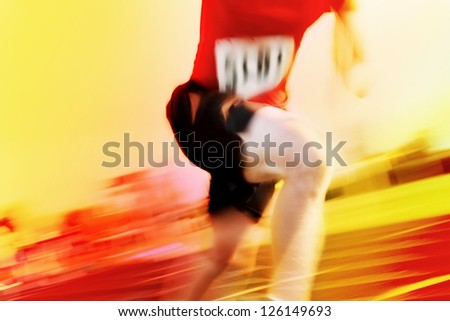 Running a race motion blur (number has been changed) - stock photo
