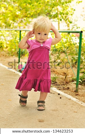 running baby girl with fair hair - stock photo