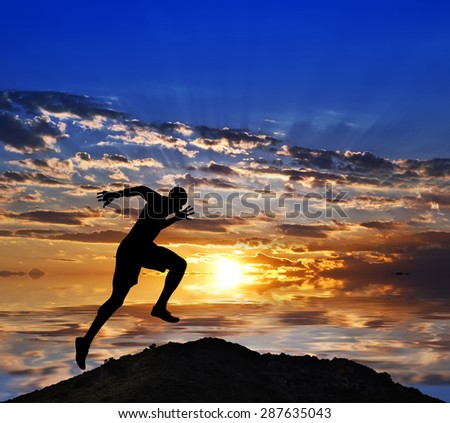 running back down the mountain - stock photo