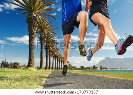 running couple jump with speed and fitness sprint race - stock photo